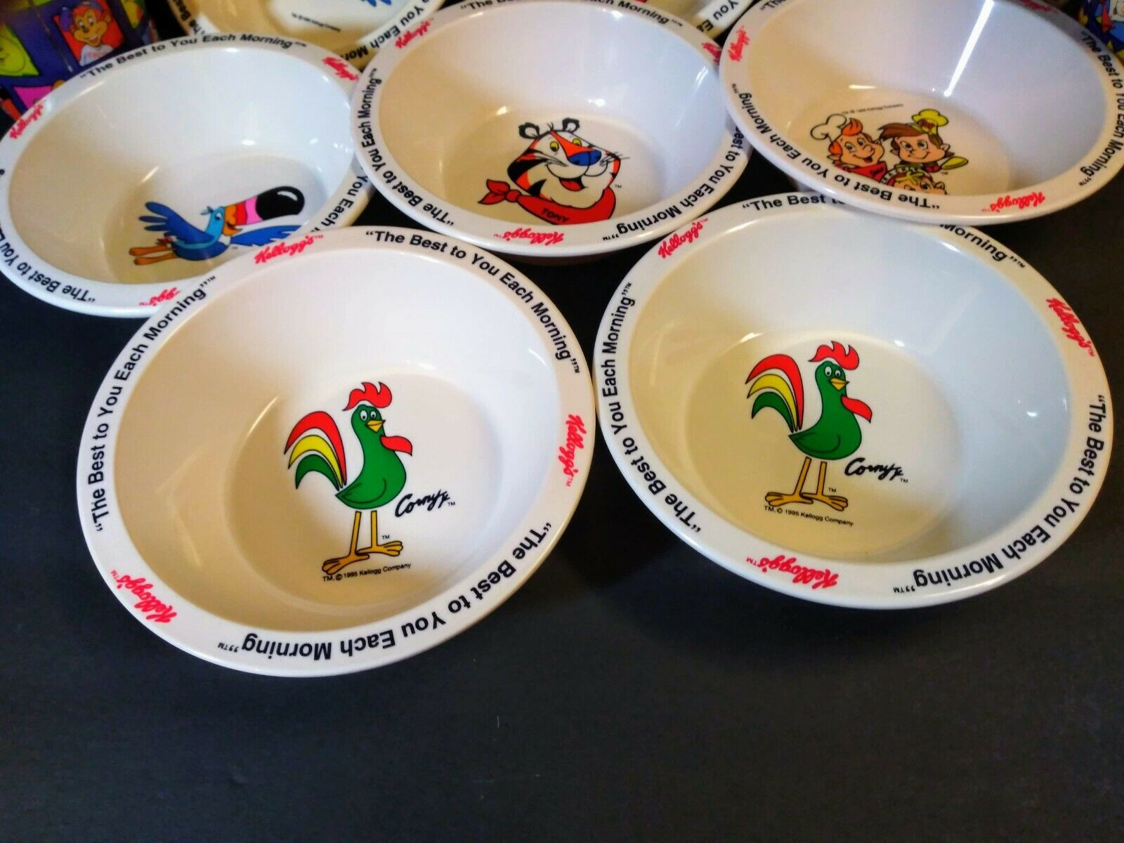 Primary image for 8 Vintage Kelloggs Cereal Bowls New 1995 4 breakfast cups tony tiger snap toucan