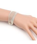 UE- Striking Multi Strand Gold Tone Designer Beaded Bracelet With White ... - $15.99