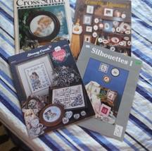 4 cross stitch magazines  - $3.95