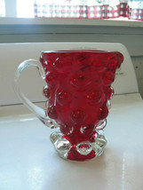 Red glass pitcher, old, with big round bubbles, balls all around it on top - $37.53