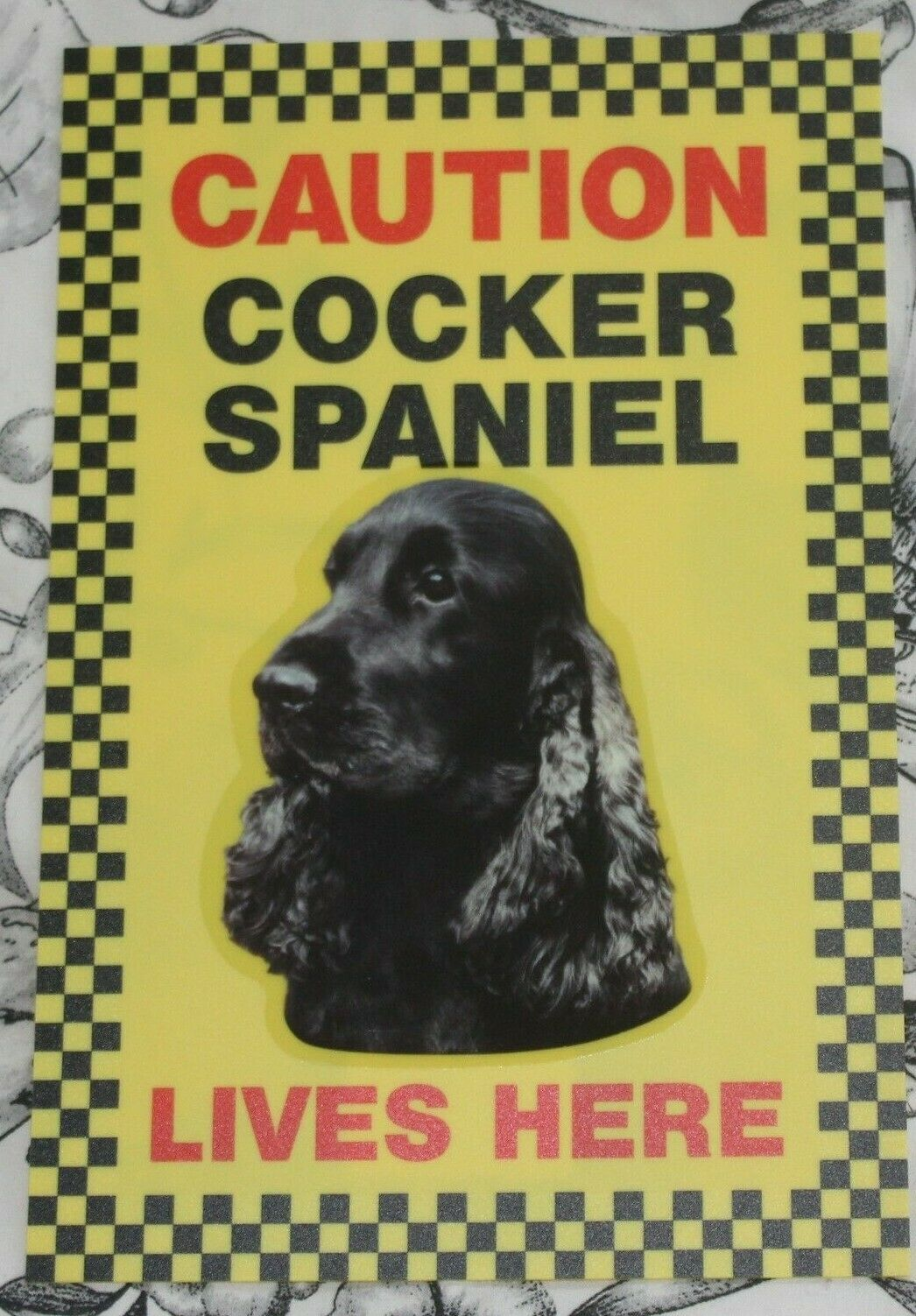 Primary image for CAUTION COCKER SPANIEL LIVES HERE -  DOG SIGN BLUE ROAN