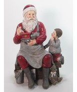 """Faux Wood Santa Claus with Toy Train and Child 9.5"""" T x 6"""" W x 5"""" - $45.49"""