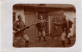 World War 1 real photo post card: German soldiers spar with bayonets - $31.68