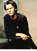 River Phoenix teen magazine pinup clipping sitting in a black chair cutie