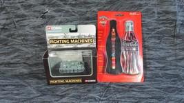 Two Unopened Items Coca Cola Tin w/ Roller Pen, Corgi Fighting Machine Tank - $11.29