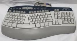 Microsoft Natural Multimedia Keyboard 1.0A  RT9470 - Ergonomic - Wired - PS2 - $39.19