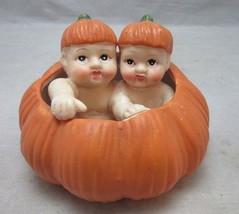 2 babies in a pumpkin Halloween, Fall ceramic figurine - $16.99