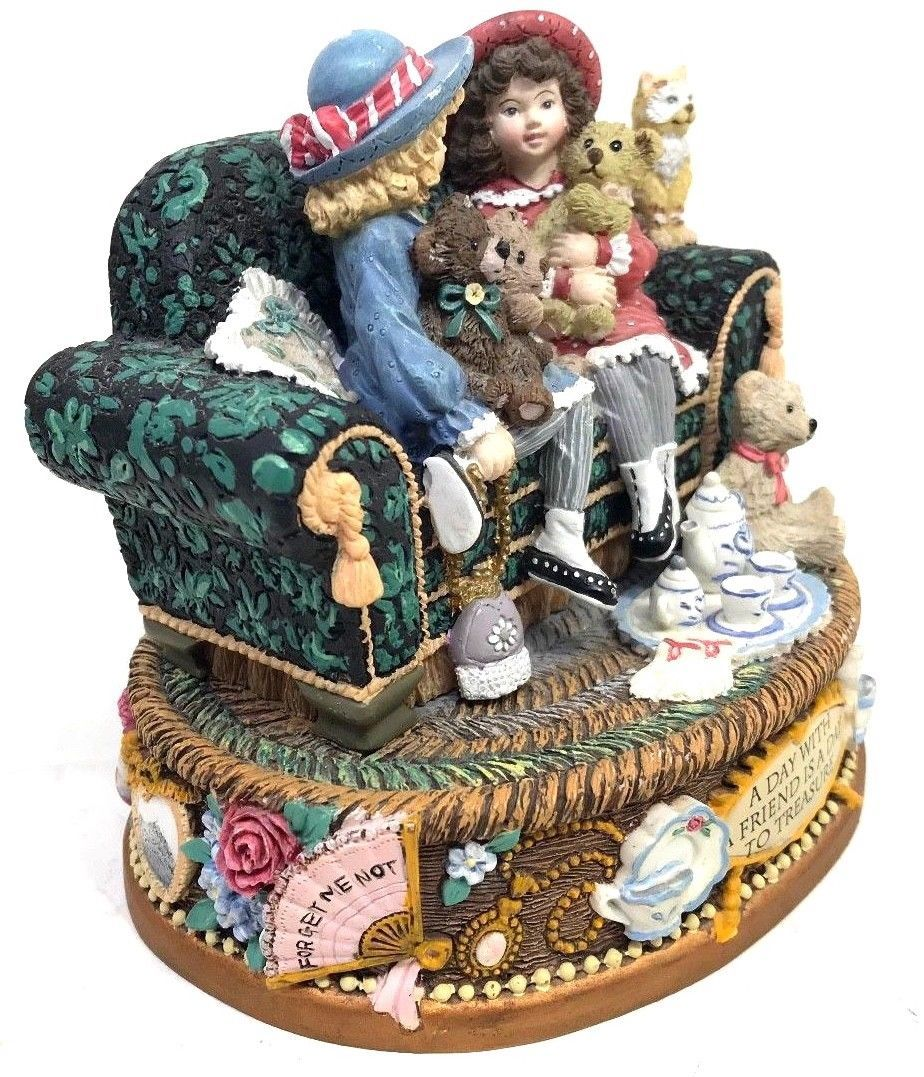 Two little girls sitting on a sofa San Francisco Music Box Co 1997 Figurine Only