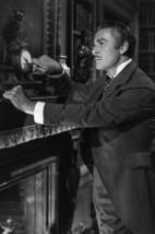 Errol Flynn in That Forsyte Woman Adjusting time on Clock 24x18 Poster - $23.99