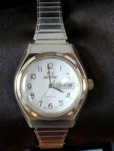 Nelsonic women's quartz day/date function pre-owned watch with Speidel e... - $19.53