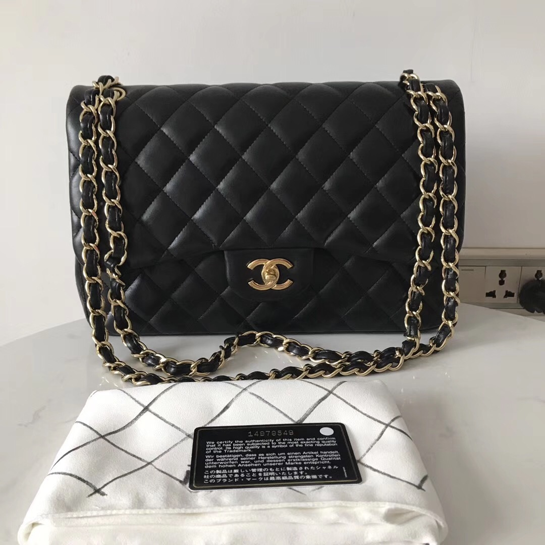 100% Authentic Chanel Black QUILTED LAMBSKIN JUMBO CLASSIC DOUTFLAP BAG Ghw