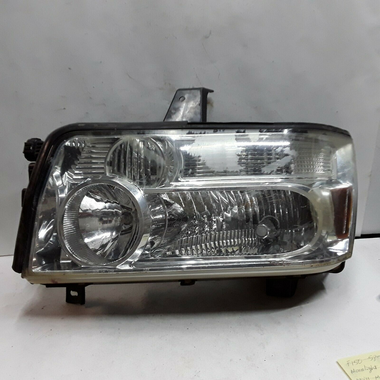 Primary image for 05 06 07 08 09 10 Infiniti QX56 left driver side headlight assembly peeling OEM