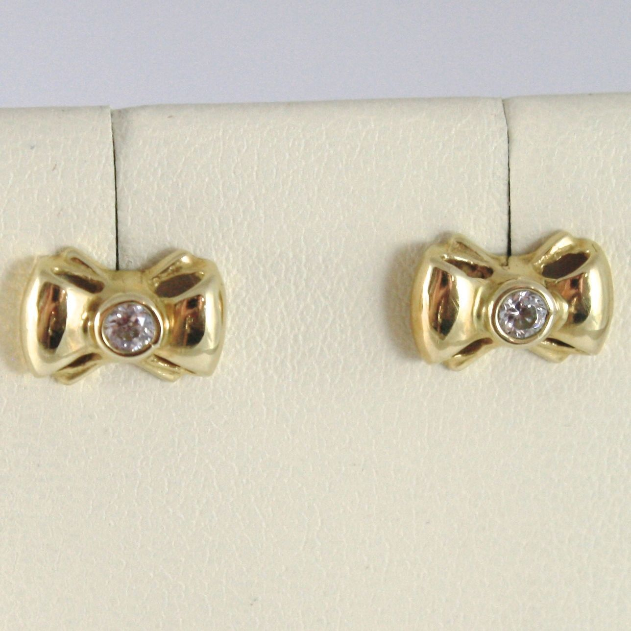 YELLOW GOLD EARRINGS 750 18K, BOW, LONG 0.7 CM, WITH ZIRCON