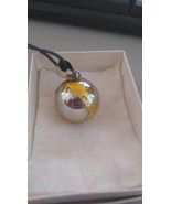 Silver ball necklace with raised globe markings with windchime inside - $214.69