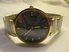 Geneva Wristwatch Round Black Face Gold & Silver Toned Back Elegant - $29.00
