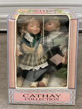 Cathay Depot Porcelain Irish Kissing Dolls on a Swing - $20.00