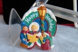 Colors of Christmas Happy Holiday Pin Victorian Carolers Resin New Avon ... - $7.19