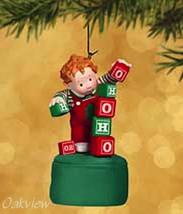 Hallmark 2002 Teetering Toddler *NIB* Press Button Blocks Tumble Ornament - $5.90