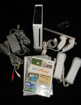 Nintendo Wii White Console Bundle w/Manuals - $89.09