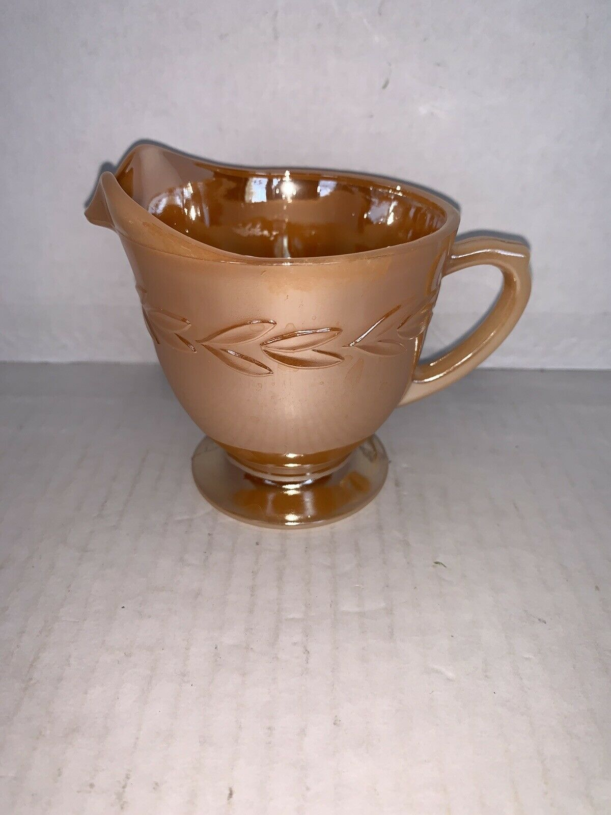 Primary image for Vintage FIRE KING PEACH LUSTER LAUREL Creamer 3""
