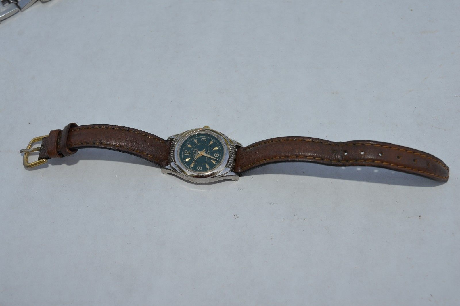 Vintage Kathy Ireland Green dial Quartz Watch Leather band, Keeping time