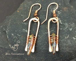 Handmade copper earrings: long curves with wire wrapped amber glass dagg... - $25.00