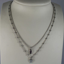 .925 RHODIUM SILVER DOUBLE WIRE NECKLACE WITH PURPLE CRISTAL AND CROSS image 1