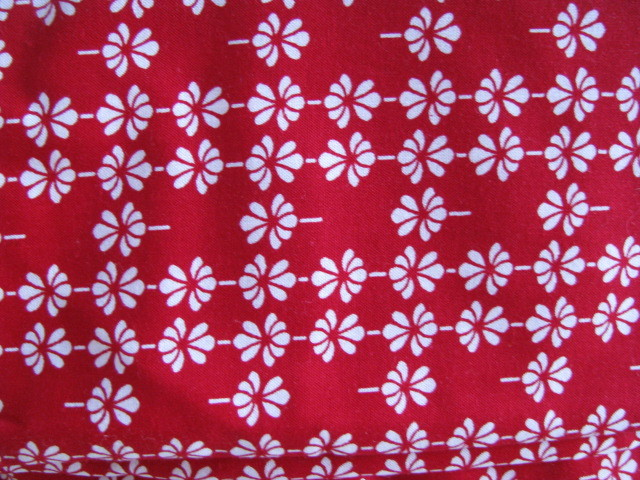 White Small Daisy Like Flowers on Red Cotton Fabric