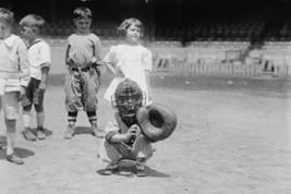 Pint sized Catcher awaits a pitch in Children's Baseball Game - Art Print - $19.99+