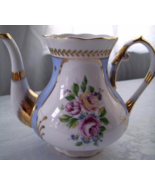 VICTORIAS GARDEN TEAPOT AND TEA CUP SET - $30.00