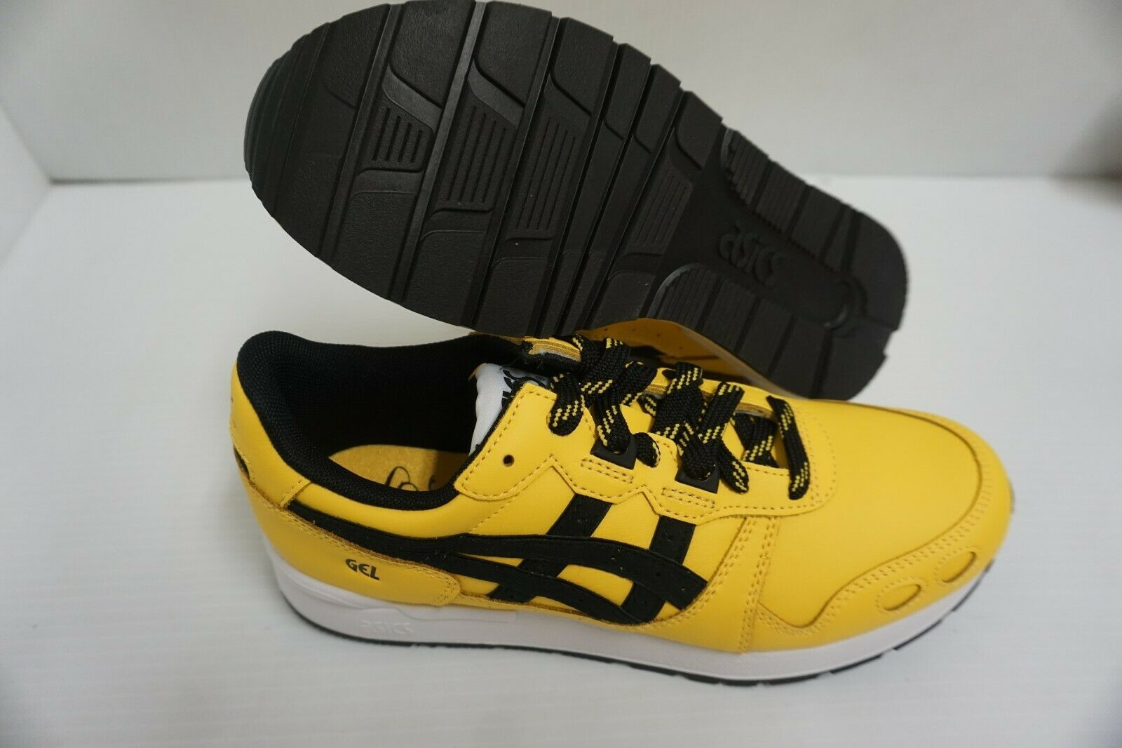 Primary image for Asics men gel lyte tai chi yellow black running shoes size 7.5 us
