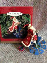 1999 HALLMARK ORNAMENT KRINGLE'S WHIRLIGIG - SANTA ON BICYCLE image 4