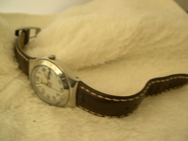 """M03, SWATCH Irony, Silver Face, 8.5"""" Stitched Leather Band, month and day - $39.99"""