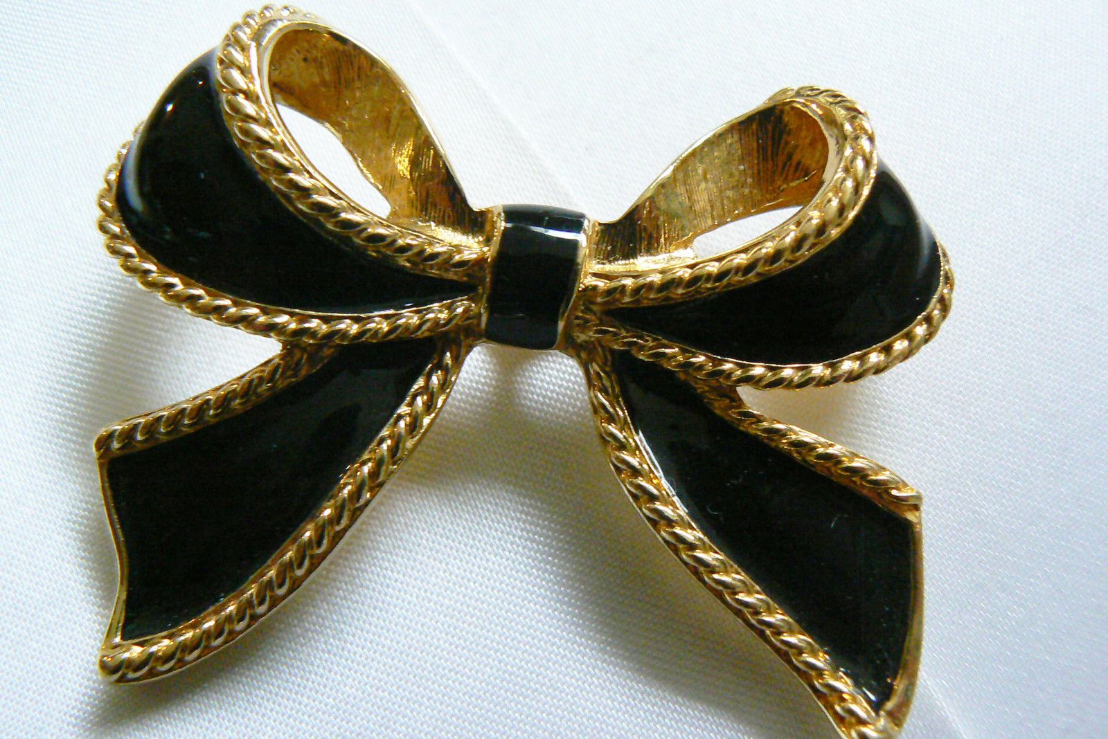 Vintage KJL for AVON Black Enamel Ribbon Bow Bolo slide Clip Pendant gold tone