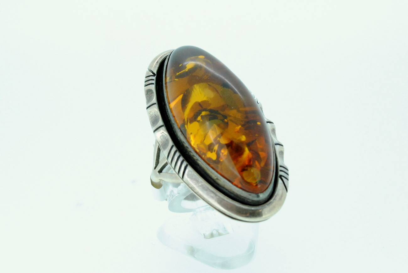 Ladies ring with amber stone set in sterling silver