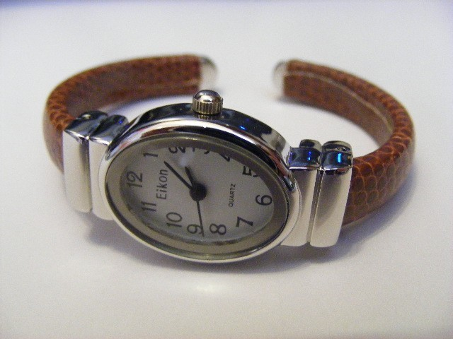 Primary image for EIKON DARK  CARAMEL BROWN  LEATHER BAND OVAL FACE  IN A   NARROW BAND CUFF WATCH