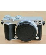 Nikon 1 J5 Mirrorless Digital Camera NO lens - Silver (Body Only) - $189.00