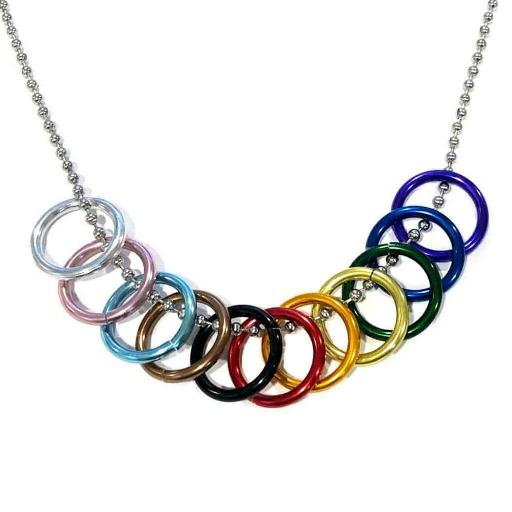 "Primary image for PROGRESS PRIDE FREEDOM RINGS NECKLACE 20"" Chain LGBTQ Inclusive Rainbow Flag NEW"