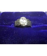 V06 AVON sz 6 ring: oval solitaire atop designed silver scallop band. Gi... - $4.99