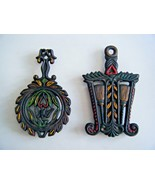 Vintage Cast Iron Footed Trivets Painted Designs Set Of Two - $14.80