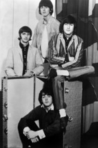 The Beatles The Fab Four sitting around luggage trunk 18x24 Poster - $23.99