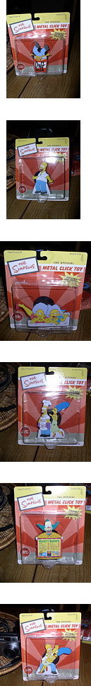 Simpsons set of 6 Tin motion clicker Toys Mint On Card