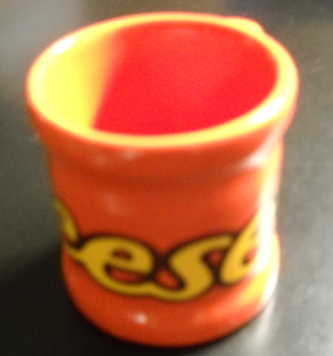 Reese's Shot Glass Ceramic Orange Body with Yellow and Brown Name Wrapping Glass