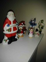 Collection of holiday ornaments - Penguin, Snowman and Santa figurine. -... - $15.00