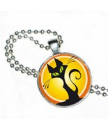 Halloween Green Eyed Black Cat Sitting on Round Crystal and Silver Plated Pen... - $16.99