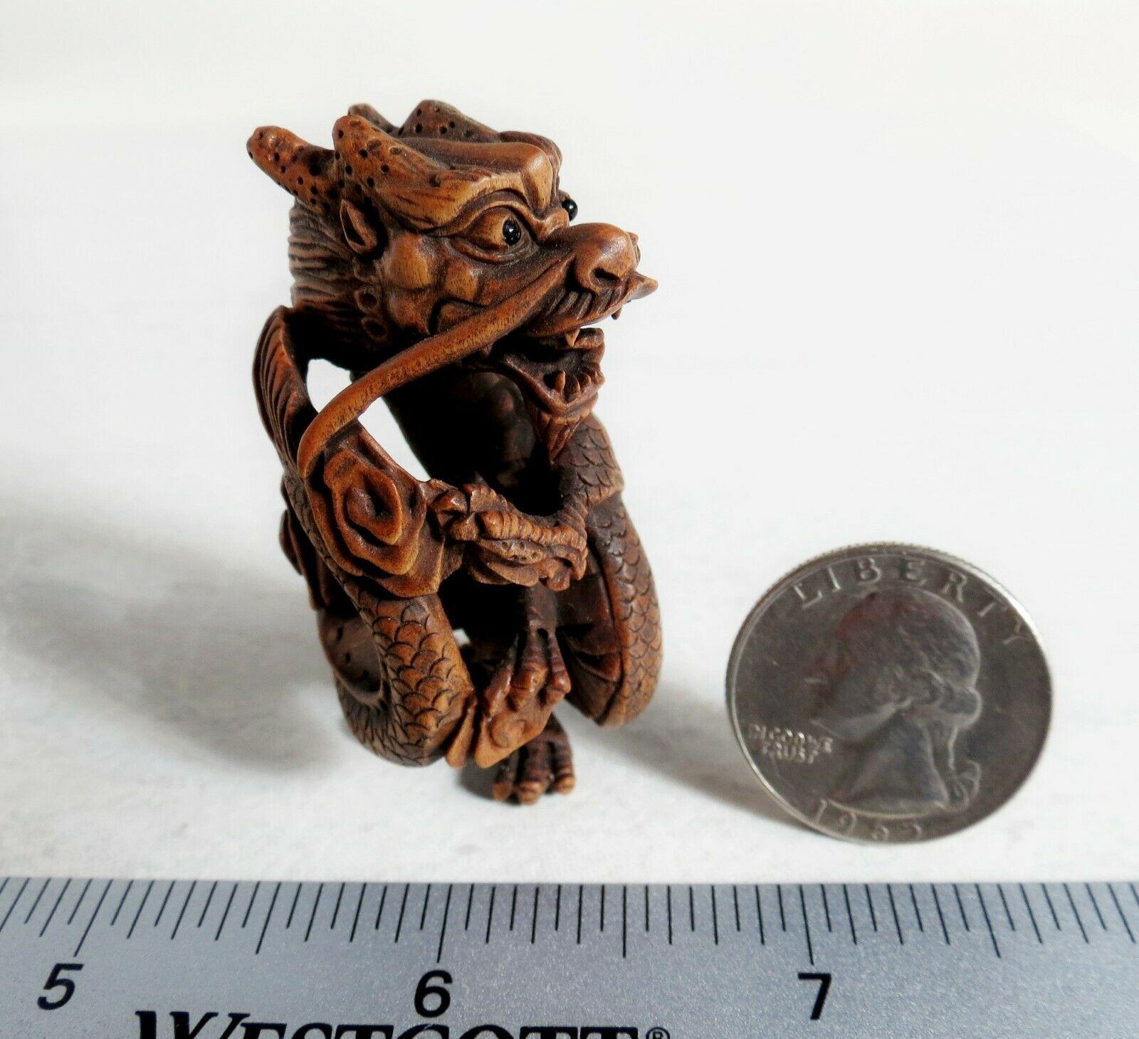 20th century Japanese boxwood Netsuke Standing dragon Unsigned unknown onyx eyes