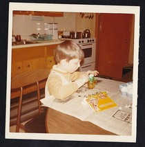 Vintage Photograph Little Boy Sitting At Kitchen Table Coloring Easter E... - $6.93