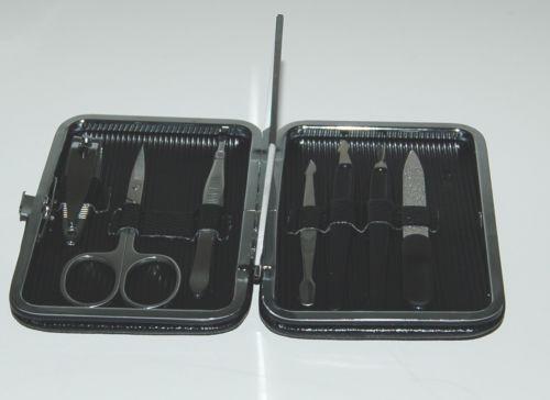 Generic Eight Piece Manicure Set Mirror Black Case Wallet Size