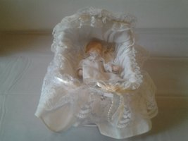 Vintage porcelain baby doll with lace cradle and pillow - $29.99