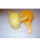 Lot 5 Vintage Yellow Tupperware Dry Measuring Cups Set and Funnel - $8.99